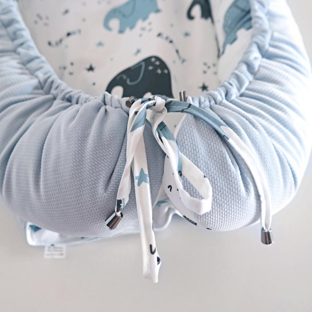 sposob zawiazywania w kokonie gniazdku dla niemowląt
